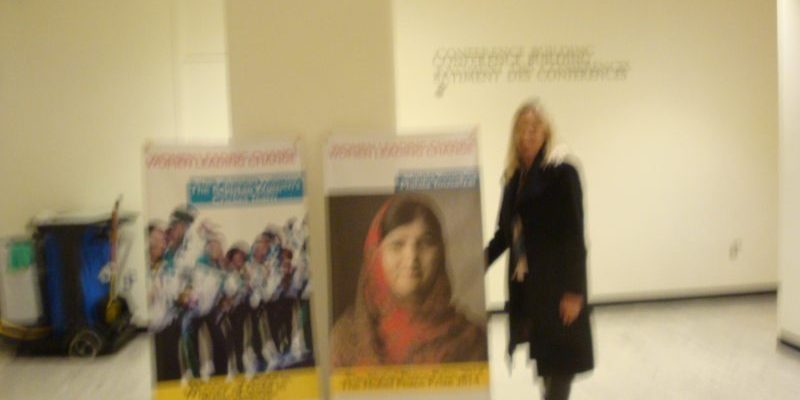 Melissa with posters of Malala and others